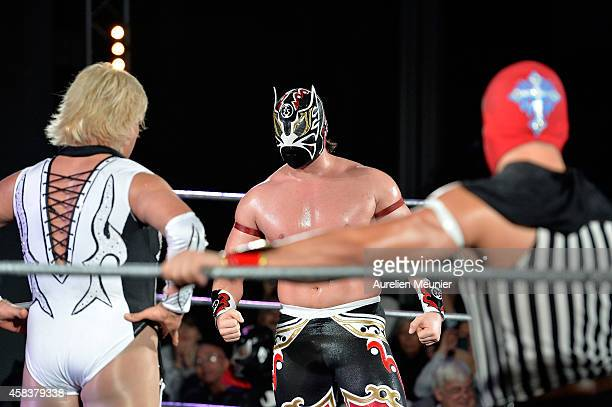 Diva Salvaje Magnus and Niebla Roja perform onstage during the EXOTICOS VS LUCHADORES Lucha Libre Show hosted by La Fondation Cartier in Paris on...