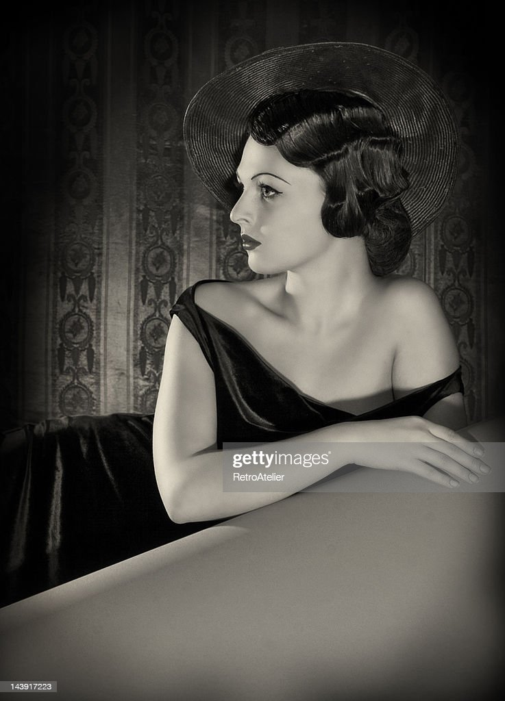 Diva with the hat in film noir style. : Stock Photo