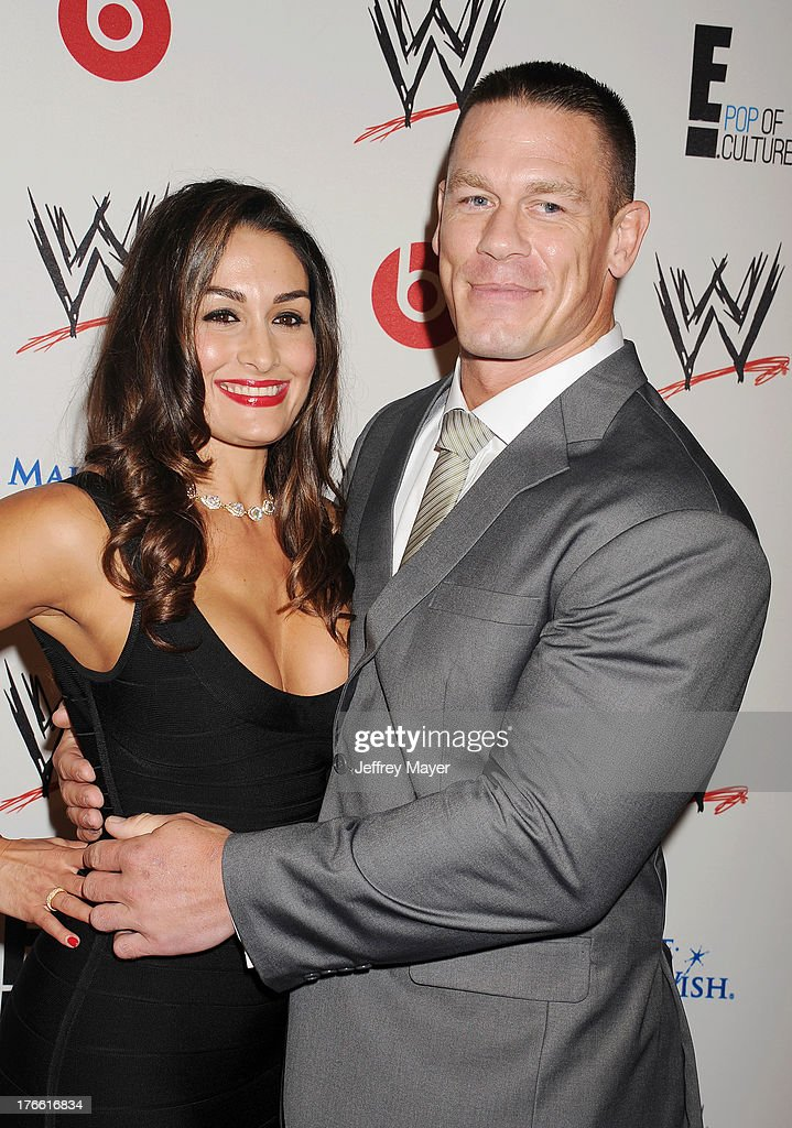 WWE Diva WWE Diva Nikki Bella (L) and professional wrestler <a gi-track='captionPersonalityLinkClicked' href=/galleries/search?phrase=John+Cena&family=editorial&specificpeople=644116 ng-click='$event.stopPropagation()'>John Cena</a> attend WWE & E! Entertainment's 'SuperStars For Hope' at the Beverly Hills Hotel on August 15, 2013 in Beverly Hills, California.