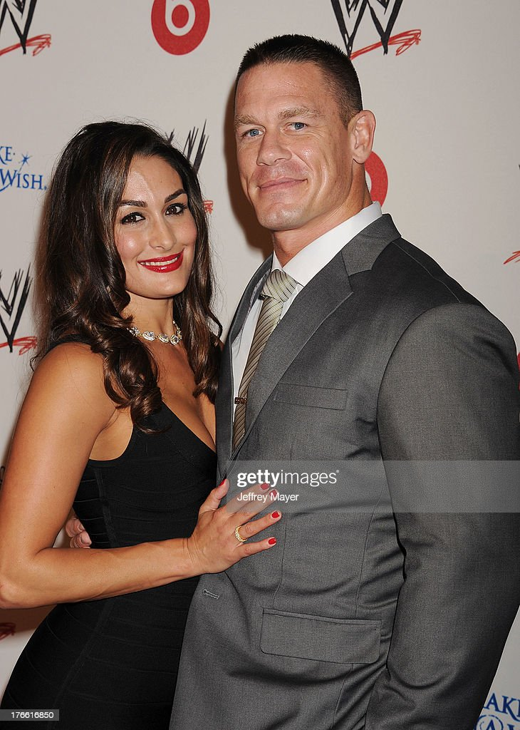 WWE Diva WWE Diva Nikki Bella (L) and professional wrestler John Cena attend WWE & E! Entertainment's 'SuperStars For Hope' at the Beverly Hills Hotel on August 15, 2013 in Beverly Hills, California.