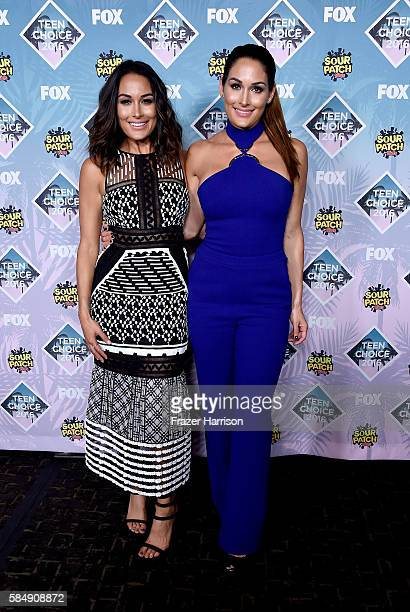Divas Brie Bella and Nikki Bella pose in the press room during Teen Choice Awards 2016 at The Forum on July 31 2016 in Inglewood California