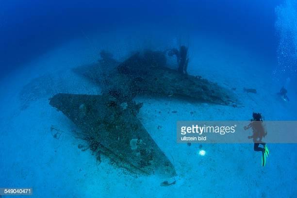 Diver and Bomber on Port Side of USS Saratoga Marshall Islands Bikini Atoll Micronesia Pacific Ocean
