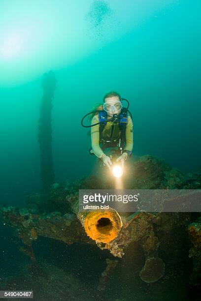 Diver and Gun of Japanese Warship of II World War Helmet Wreck Micronesia Palau
