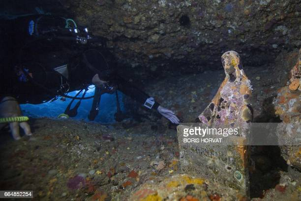 A diver approaches a Virgin Mary statue known as 'Gaby's Virgin' on April 5 2017 in the sea off La Ciotat southern France A Virgin Mary statue known...