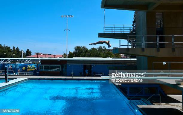 TOPSHOT A diver practices her routine as journalists tour the University of California Los Angeles campus which will host the Athelete's village and...