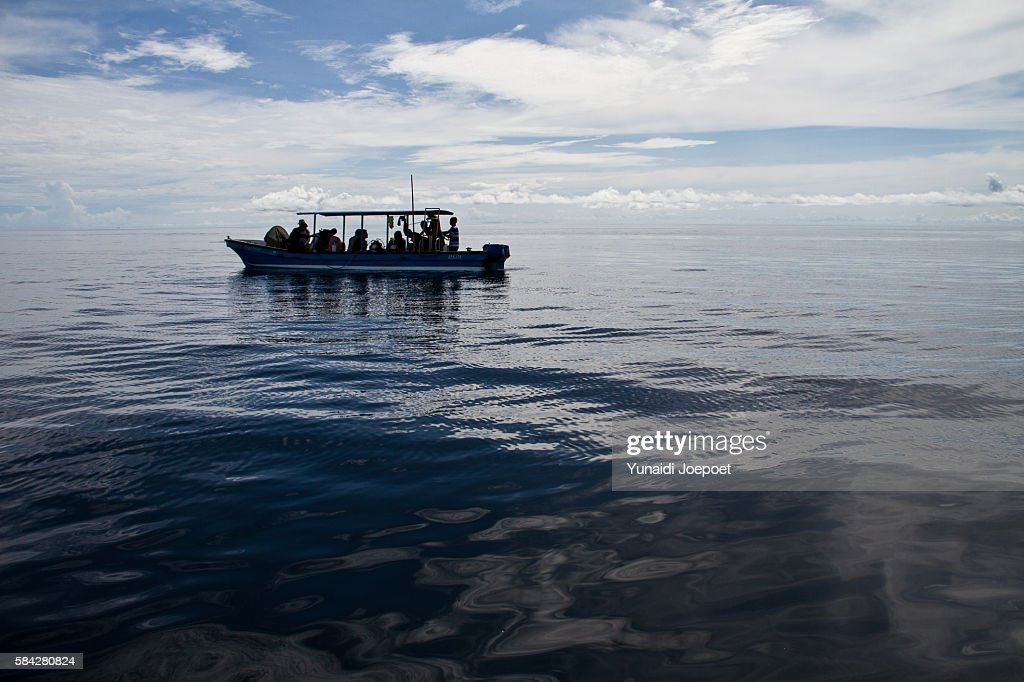 Diver Sailing with Boat to Dive Spot