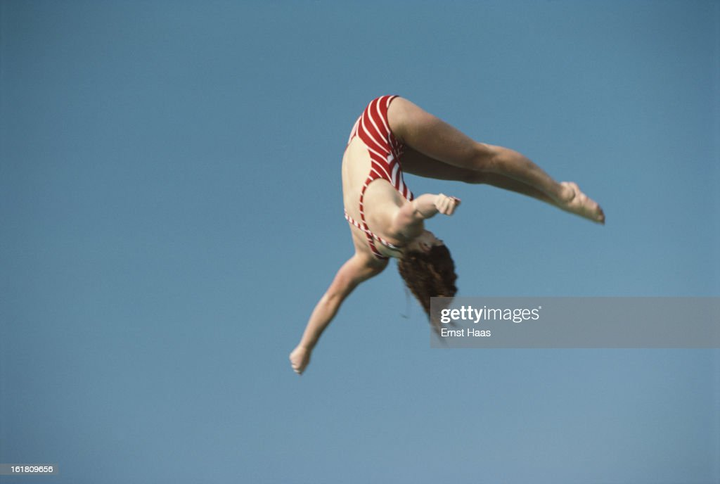 A diver somersaults through the air March 1984