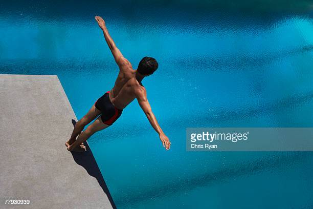 Diver standing on diving board