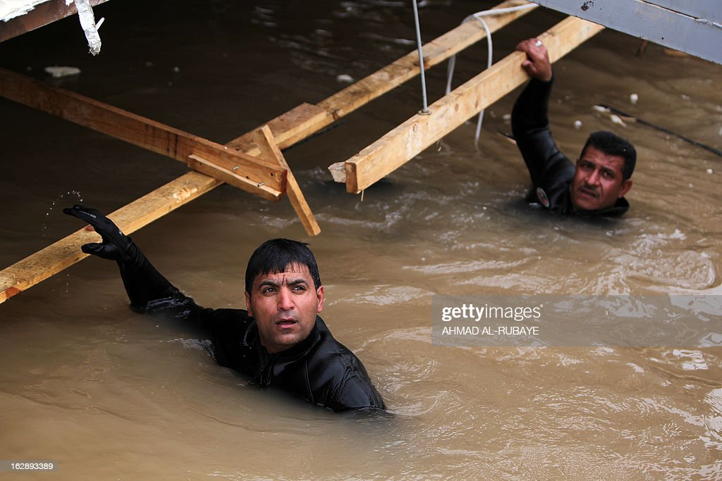 Divers belonging to an Iraqi search and rescue team try to recover the bodies of five people killed on February 28, after the sinking of a floating restaurant belonging to the Lebanese Club in Baghdad, on March 1, 2013. A floating restaurant moored on the bank of Baghdad's Tigris River sank on February 28, during a private party with 150 people on board, leaving five people dead, Iraqi officials said.