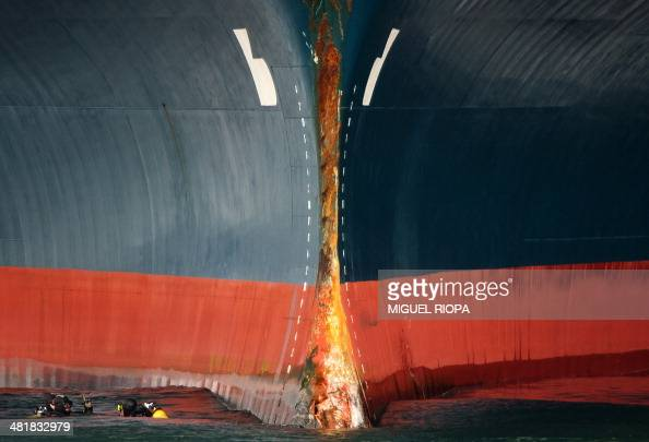 Divers check the bow of the vehiclecarrier 'Baltic Breeze' damaged following a collision with a fishing boat at Vigo's harbour on April 1 2014 Three...