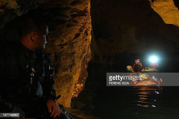 Divers explore the underwater Molnár János cave in Budapest on November 18 2008 The cave is one of the five big caves of the Rózsadomb district on...