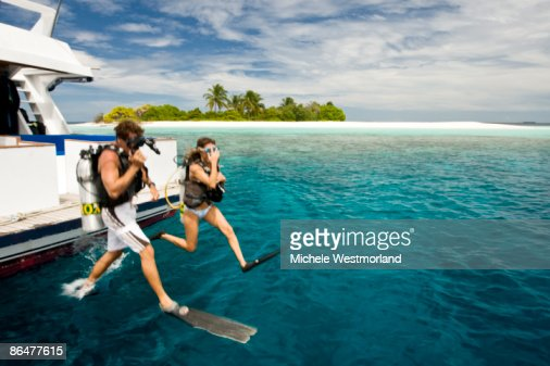 Divers Jumping into Ocean, Maldives