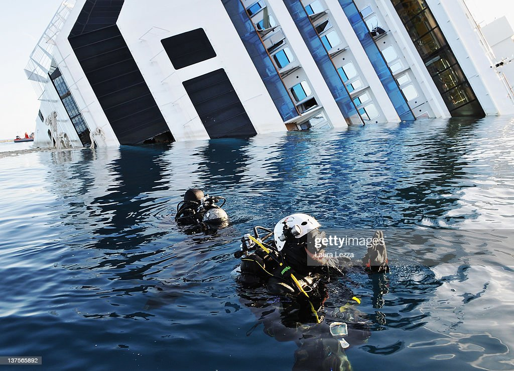 Divers of the Nucleo Operatori Subacquei Guardia Costiera (Coast Guard) conduct a SAR (Search and Rescue) operation that that led to the discovery of the body of a woman inside of the ship Costa Cooncordia on January 21, 2012 in Giglio Porto, Italy. More than four thousand people were on board when the ship hit a rock off the Tuscan coast. According to reports on January 22, 2012 complications have arisen establishing the exact number of missing passengers due to unregistered passengers that may have been onboard the vessel. Around 20 are believed to still be missing, with the official death toll now standing at 13.