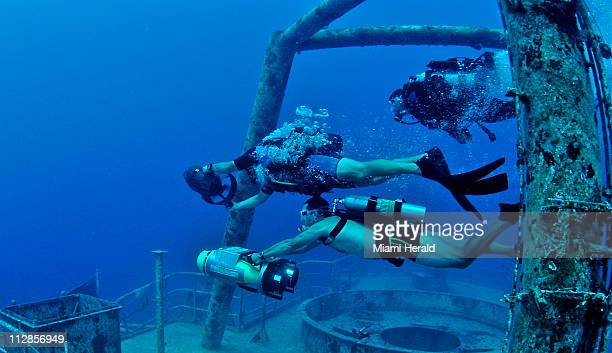 Divers participate in an underwater scooter race in June in Key West Florida on the wreck of the Vandenberg