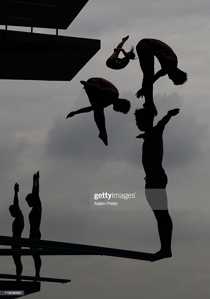 Divers practice ahead of the Women's 1m Springboard preliminary round during Day Two of the 14th FINA World Championships at the Oriental Sports Center on July 17, 2011 in Shanghai, China.