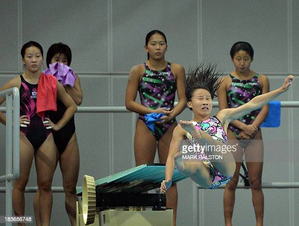 Divers practice before competing in the Women's Synchronized 3m Springboard Final at the East Asian Games held at the Tianjin Olympic Center Diving...