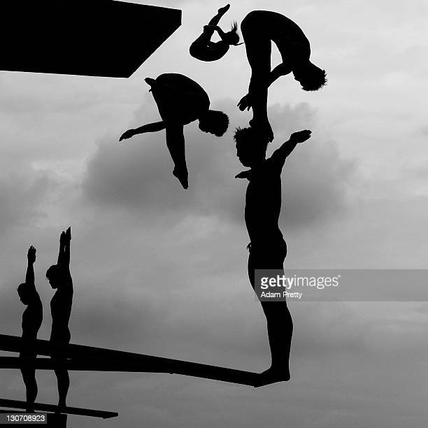 Divers practice during Day Two of the 14th FINA World Championships at the Oriental Sports Center on July 17 2011 in Shanghai China