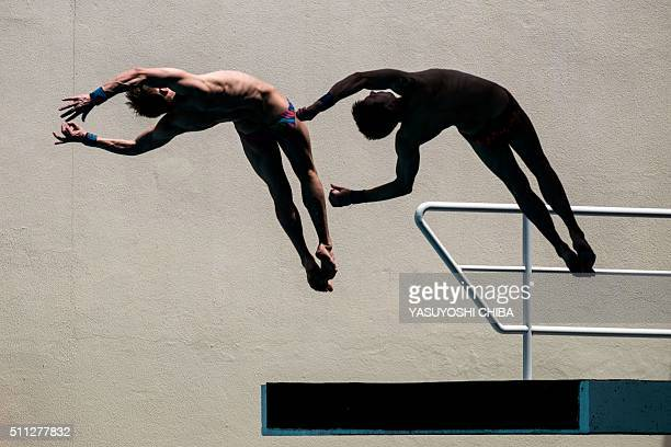 TOPSHOT Divers practice during the FINA Diving World Cup 2016 a test event for Rio 2016 at the Maria Lenk Aquatics Centre that will host the diving...