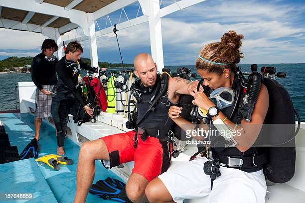 SCUBA divers preparing for dive