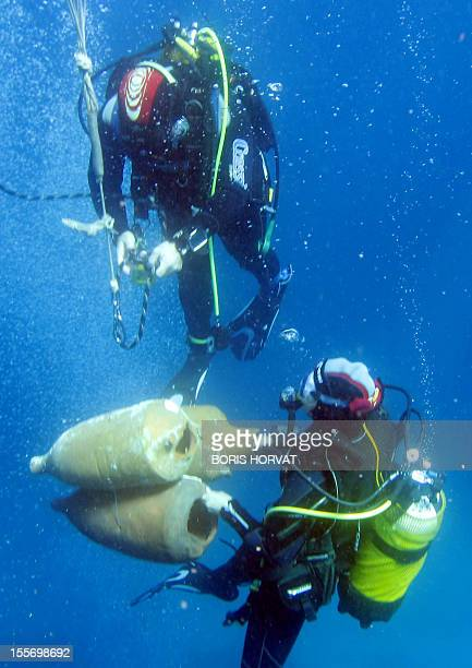 Divers submerge Roman ancient amphoras on August 18 2011 off the coast of the Frioul island southern France Discovered in 1952 by French undersea...