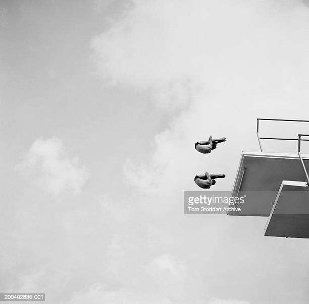 Divers take off from the 10 metre platform at the Fort Lauderdale Aquatic Complex in Florida USA June 1998