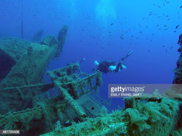 Divers take photos of the MS Zenobia shipwreck a Swedish built ferry that capsized and sank off the coast of the Cypriot port city of Larnaca in 1979...