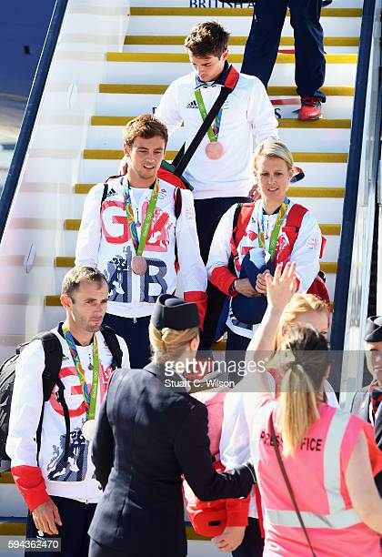 Divers Tom Daley and Daniel Goodfellow wear their bronze medals after arriving home at Heathrow Airport on August 23 2016 in London England The 2016...
