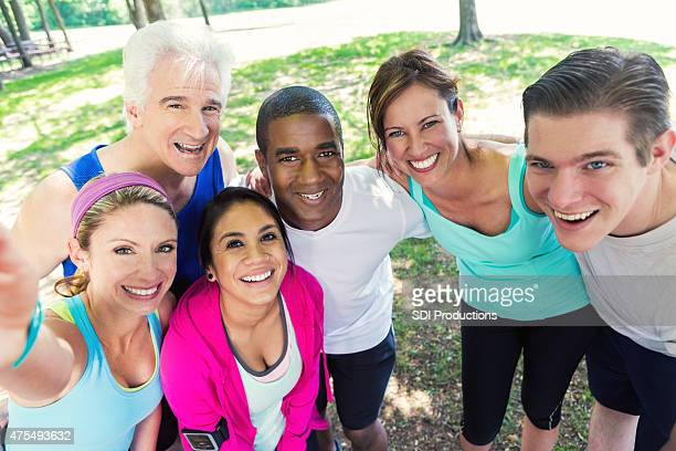 Diverse athletes posing for selfie photo after running
