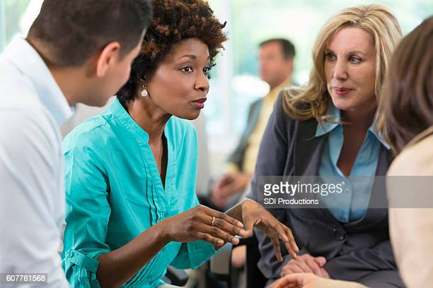 Diverse business people brainstorm during seminar