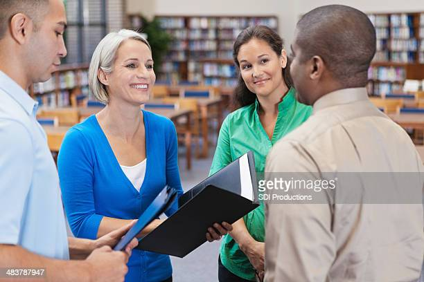Diverse business people discussing something with professional coworkers