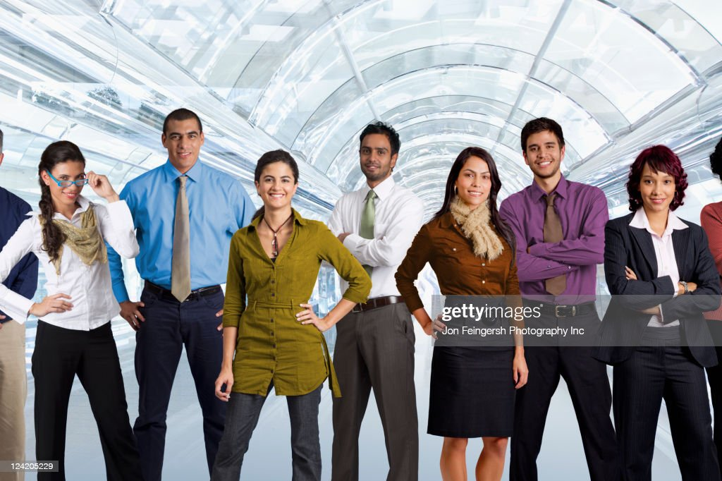 diverse business people standing in airport stock photo