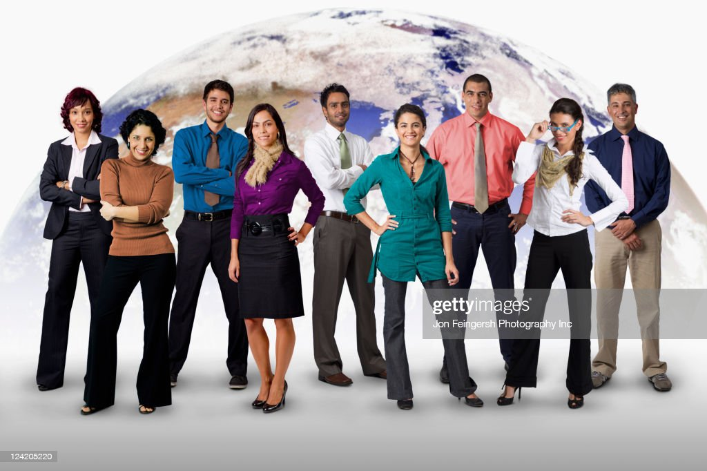 Diverse business people standing together with globe in background : Stock Photo