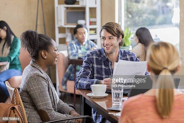 Diverse business team meets over coffee