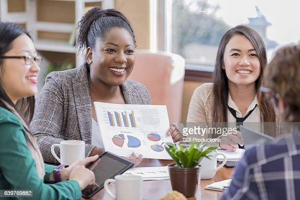 Diverse businesswomen meet up with client