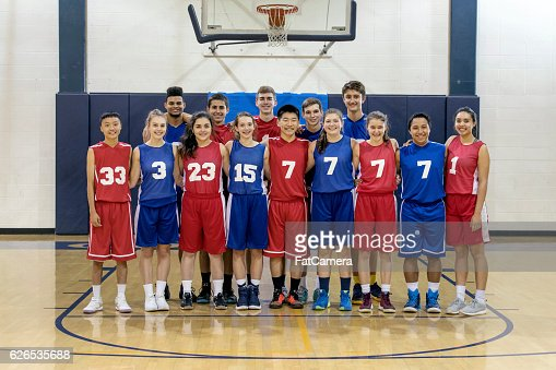 Diverse co-ed group of high school basketball players