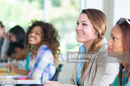 Modern Classroom With Students ~ Diverse college students listening to teacher in modern
