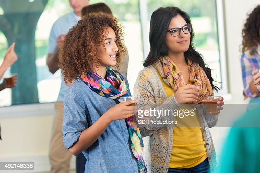 Diverse college students talking during party or mixer