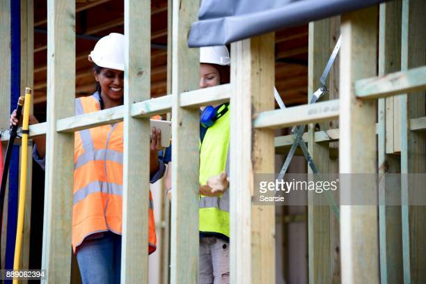 SYD112017 Diverse female Architect and Construction worker using technology