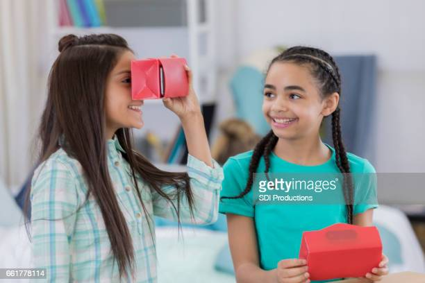 Diverse friends with virtual reality goggles