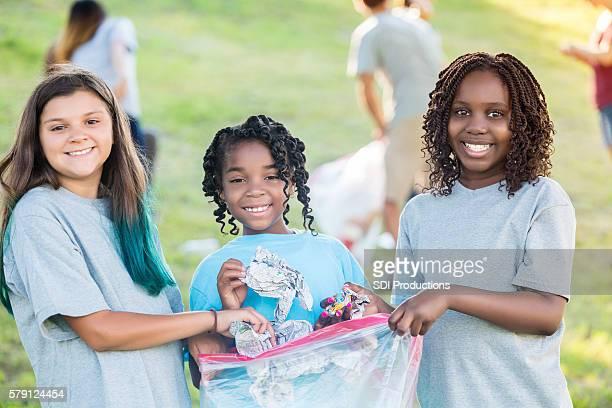 Diverse girls help clean up park