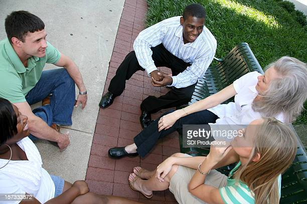 Diverse Group Discussing Outside