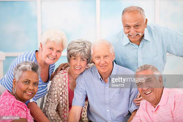 Diverse group, happy senior adult friends. Home or assisted living.