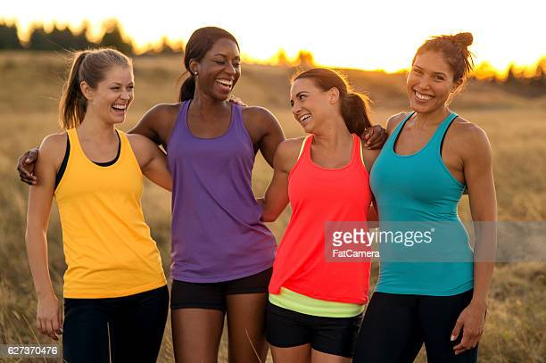 Diverse group of adult female athletes after trail running