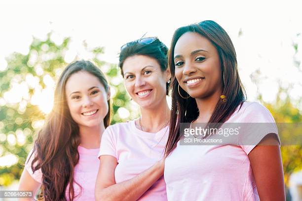 Diverse group of breast cancer survivors and awareness supporters