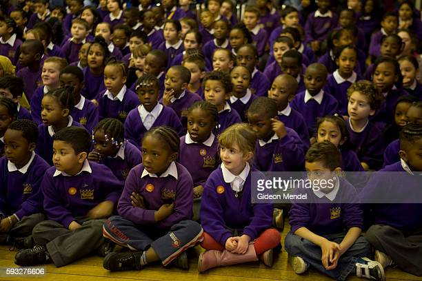 A diverse group of children at Kingsmead Primary School enjoy a special end of year school concert where all the classes were showing the school and...