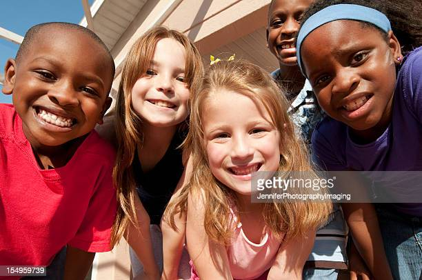 Diverse group of children posing for a picture
