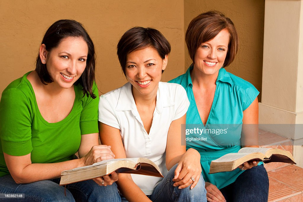 Diverse Group Of Friends Reading Stock Photo | Getty Images