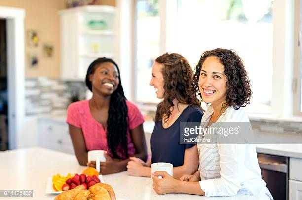Diverse group of friends talking and laughing together