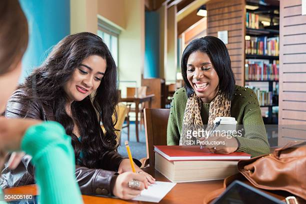 Diverse group of high school students stuyding together in group