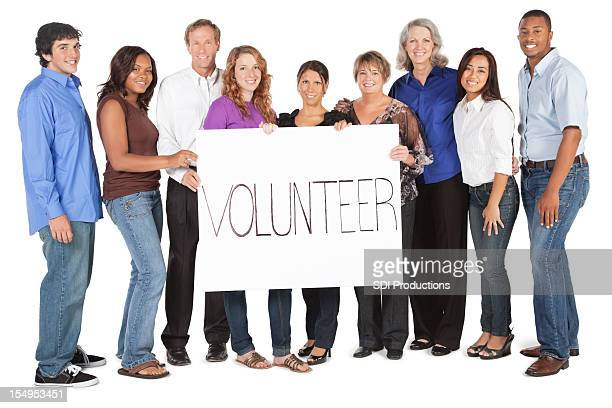 Diverse Group of People Holding Volunteer Sign
